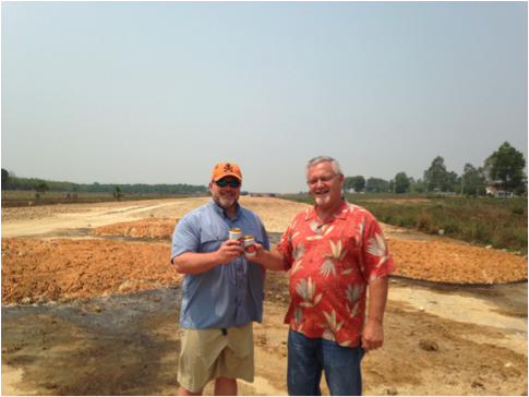 Stephen and his son stand on the Dak To airstrip, where Stephen ferried infantry during the war.