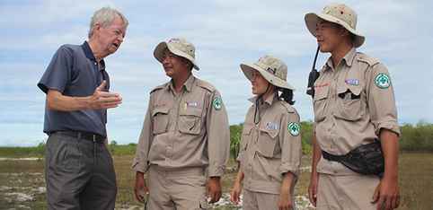 In central Vietnam, US veteran Chuck Searcy (left) discusses bomb disposal with members of Project Renew. (Photo courtesy Project Renew)