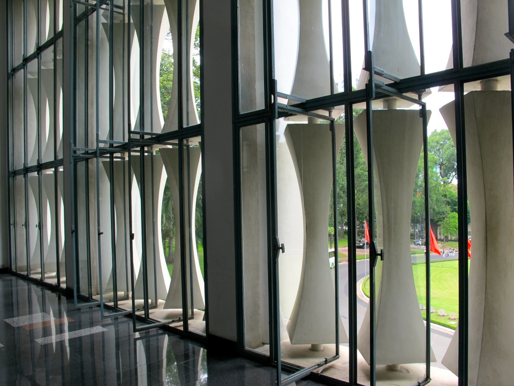 An interior hallway at Reunification Palace shows the facade's bamboo design. (Photo by Nissa Rhee, June 2014)