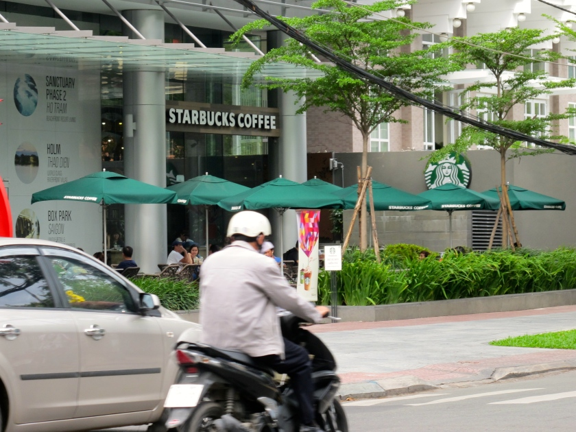 Starbucks -- which entered the Vietnamese market last year -- has an outlet across the street from the Reunification Palace, the site of South Vietnamese defeat. (Photo by Nissa Rhee, June 2014)