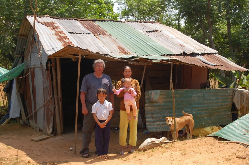 Mike Boehm with a family in Tinh Giang commune, Quang Ngai. MQI is working on getting this family a compassion house. (Photo courtesy of Phan Van Do)
