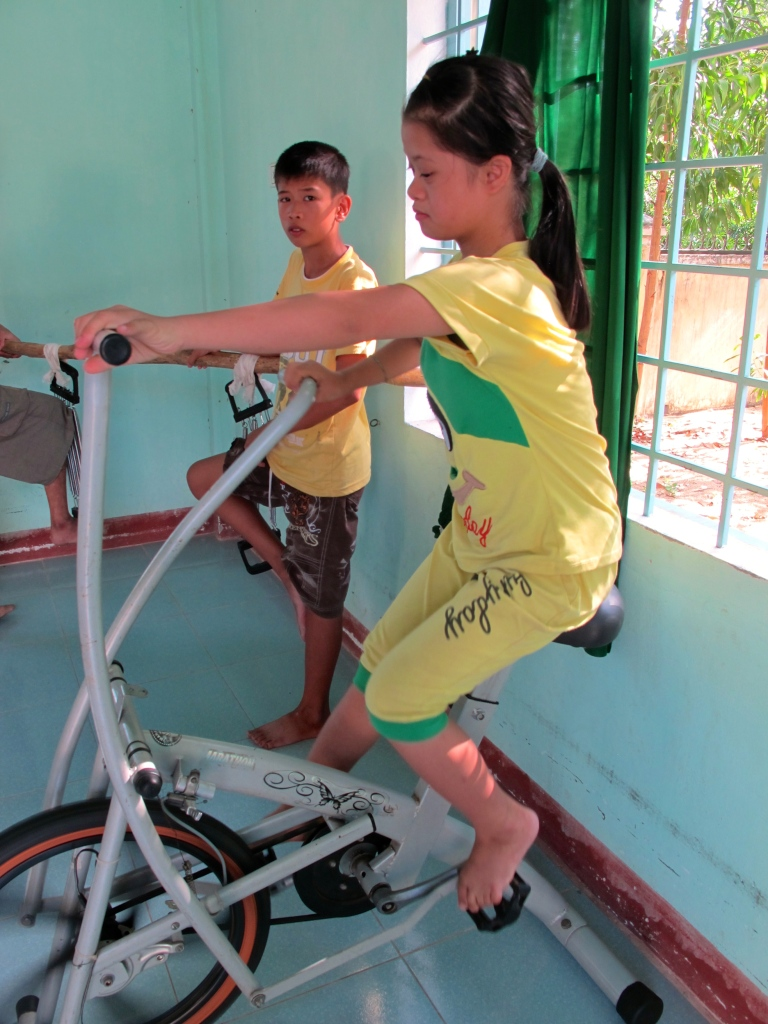 Children play at a center for victims of Agent Orange run by VAVA in Quang Ngai. (Photo by Nissa Rhee, June 2014)