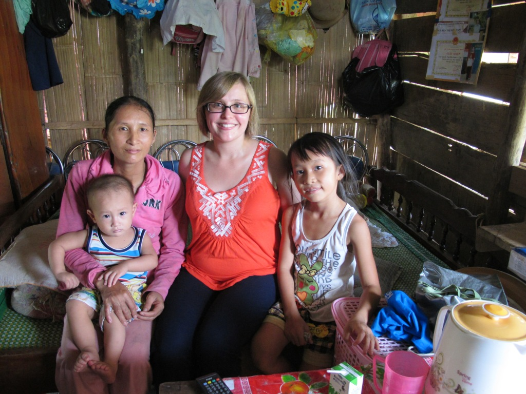 I sit with the same family inside of their home in Tinh Giang commune, Quang Ngai. (Photo by Nissa Rhee, June 2014)