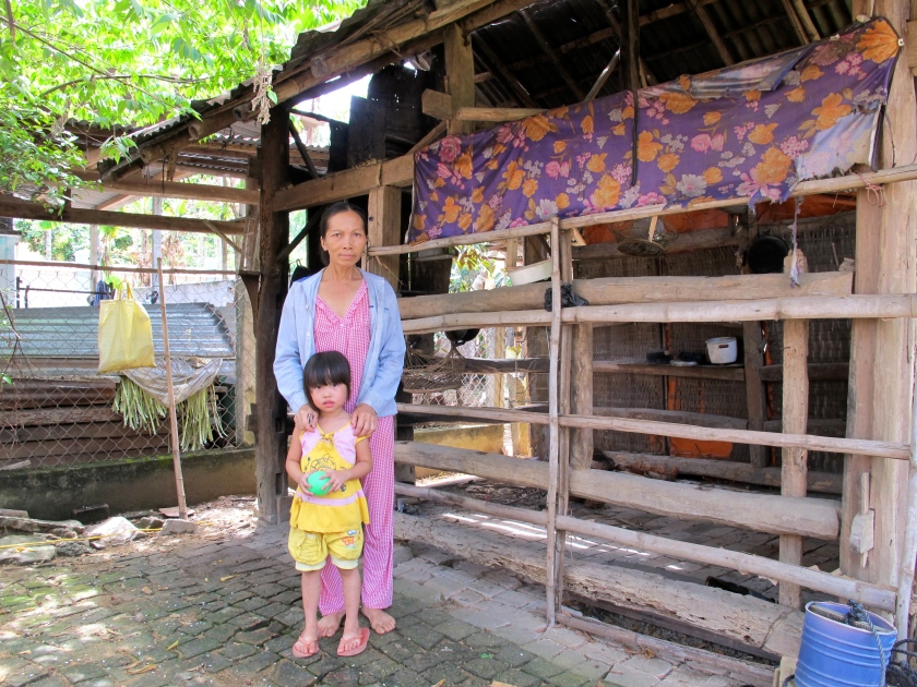 A family shows me their old house in Tinh Giang commune, Quang Ngai. (Photo by Nissa Rhee, June 2014)