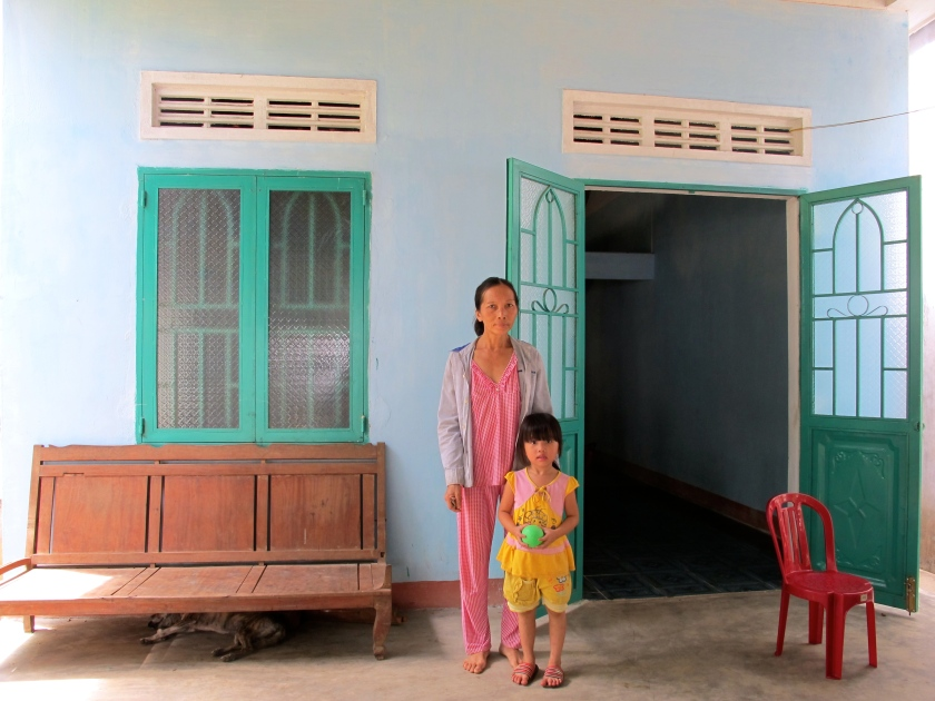 The same family with their new house in Tinh Giang commune, Quang Ngai. (Photo by Nissa Rhee, June 2014)