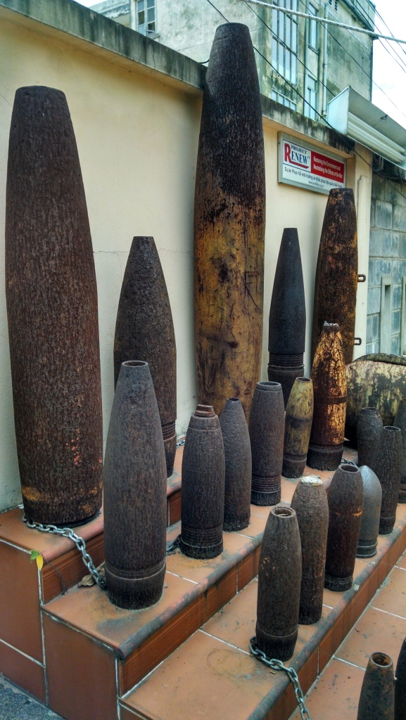 An exhibit of unexploded ordnance in the parking lot of Huu Nghi Hotel, where I was staying in Dong Ha. (Photo by Nissa Rhee, June 2014)