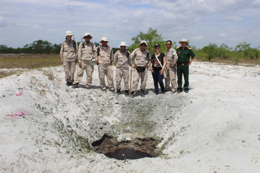 The EOD team and I stand behind the crater that formed from one of the detonations. (Photo by Nguyen Thanh Phu, June 2014)