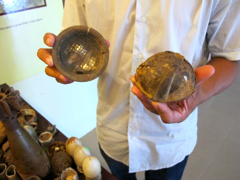 Project Renew's Nguyen Thanh Phu shows me the remnants of a cluster bomblet. (Photo by Nissa Rhee, June 2014)
