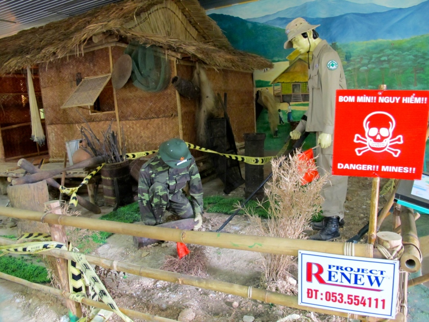A diorama at the Project Renew Visitor Center shows how UXO is cleared near people's homes. (Photo by Nissa Rhee, June 2014)