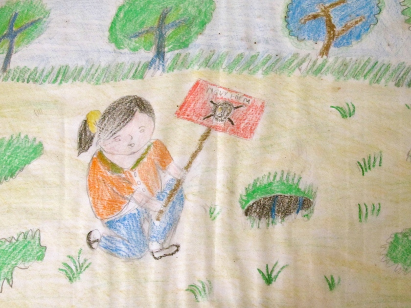 A child's drawing shows the discovery of UXO in a field. Students who come to Project Renew's Visitor Center are asked to draw something that they learned on their field trip. (Photo by Nissa Rhee, June 2014)