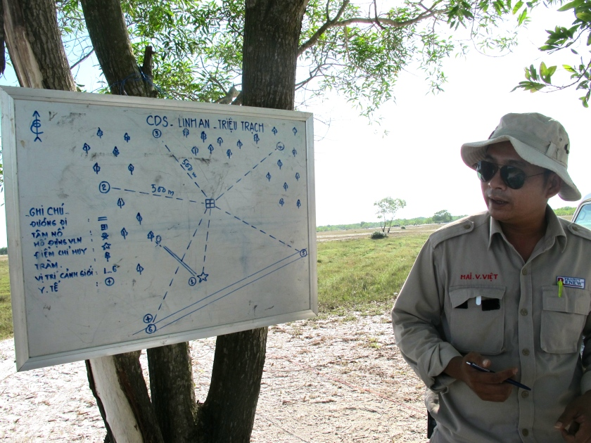 Project Renew's Explosive Ordnance Disposal (EOD) Team Leader Mai Van Viet shows me a map of the detonation site. (Photo by Nissa Rhee, June 2014).
