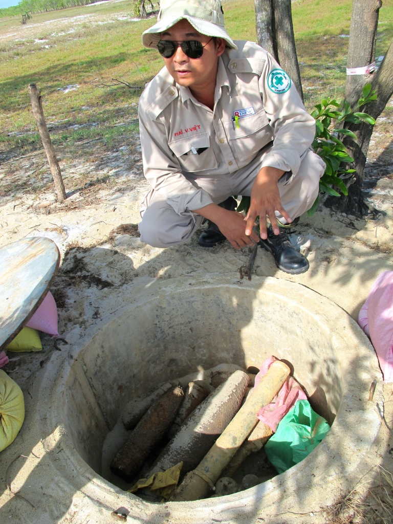 Viet shows me the dump where they store conventional UXO before they destroy it. (Photo by Nissa Rhee, June 2014)