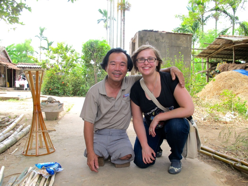 Do Thien Dang and I pose in his front yard. Do lost both of his legs when he stepped on a landmine in 1980. (June 2014)