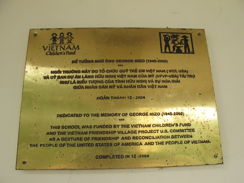Plaque in front of Friendship Village's main school