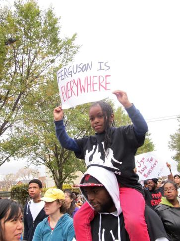 A young protester at the march on Saturday. (Photo by Nissa Rhee).